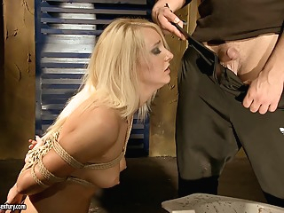 Valerie Follass in a scene of domination bdsm blonde fetish video