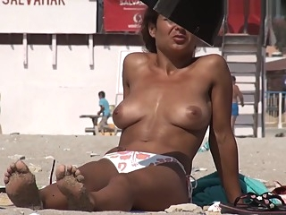 Voyeur Films Busty Brunette Girl At The Beach amateur beach big tits video