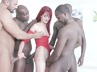 Red haired woman, Andi Rye is kneeling on the floor and sucking a big, black cock anal big cock cumshot video
