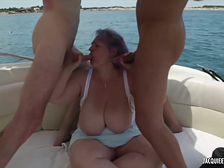 Purple haired plumper with massive tits is using her deep throat to satisfy two horny guys big tits bbw hd video