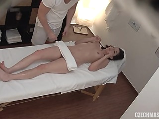 Lovely brunette with small boobs is having casual sex in a massage room and loving it massage hd brunette video