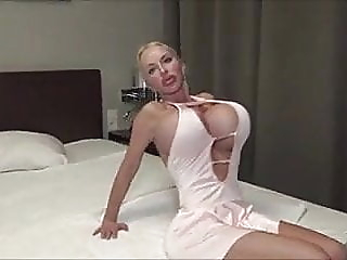 All I can say is she has huge fake breast looks okay tits big boobs milf video